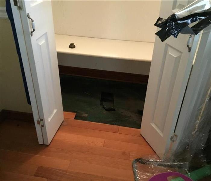 Washing machine slow leak in Winnetka, CA causes water damage Before